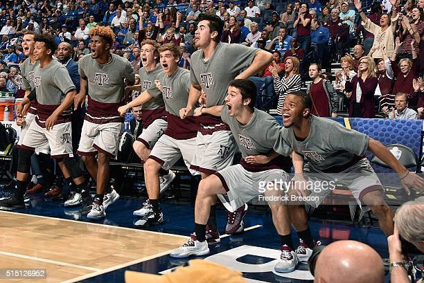 Players on the bench of the Texas AM Aggies react after a dunk by a teammate during the second half of an SEC Basketball Tournament Semifinal game...