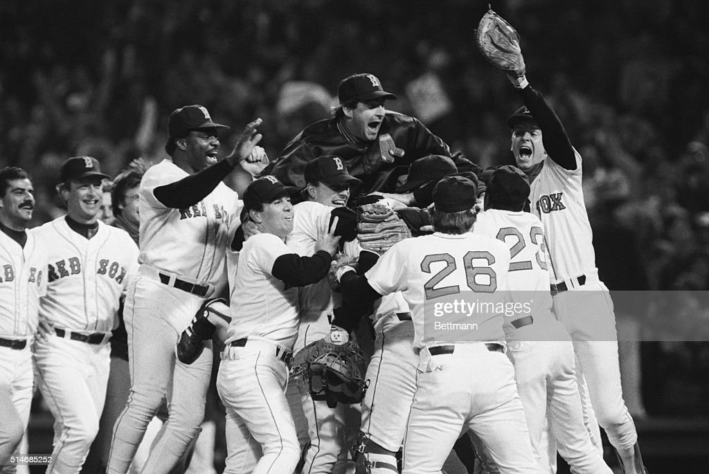 Players on the Boston Red Sox celebrate their American League championship victory, including Don Baylor (3rd from left), Bruce Hurst (top), Dave Stapleton (right), and playoff MVP Marty Barrett (left, in front of Baylor). October 15, 1986.