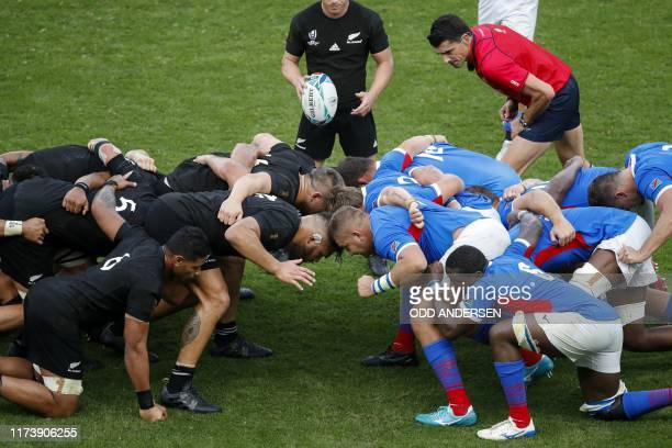 Players pack a scrum during the Japan 2019 Rugby World Cup Pool B match between New Zealand and Namibia at the Tokyo Stadium in Tokyo on October 6,...