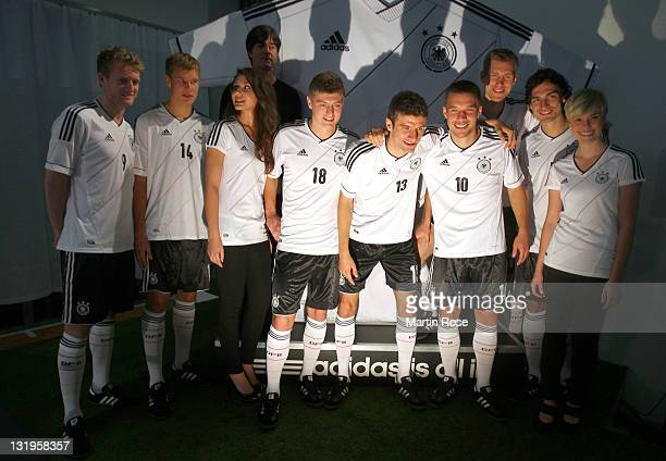Players parade the new national team Euro 2012 jersey during the Germany national team Euro 2012 jersey launch at Mercedes Benz Center on November 9...