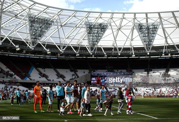 Players parade with family members to thank the crowd during the Premier League match between West Ham United and Liverpool at London Stadium on May...