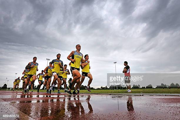 Players participate in a 2km time trial during a St Kilda Saints AFL preseason training session at Casey Fields on November 24 2014 in Melbourne...