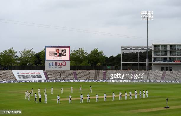 Players pause for a minute's silence in memory of Everton DeCourcy Weekes on the first day of the first Test cricket match between England and the...