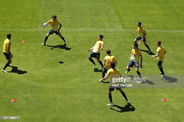 Players perform a training drill during a Socceroos Training Session at WIN Jubilee Stadium on November 13 2013 in Sydney Australia