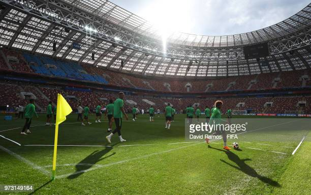 Players perform drills during a Saudi Arabia training session ahead of the 2018 FIFA World Cup opening match against Russia at Luzhniki Stadium on...