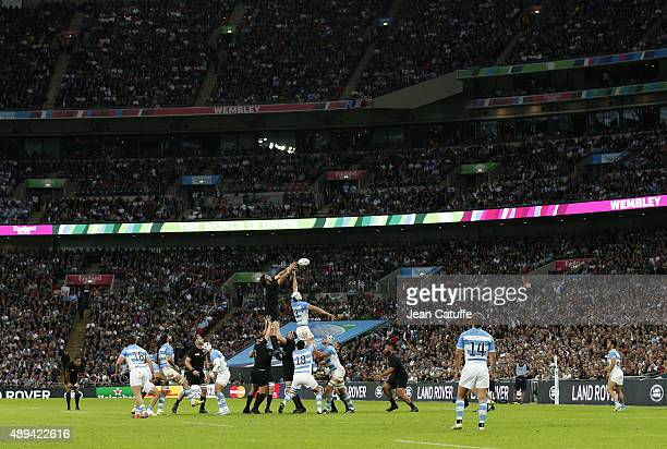 Players perform in a packed stadium during the Rugby World Cup 2015 match between New Zealand and Argentina at Wembley Stadium on September 20 2015...