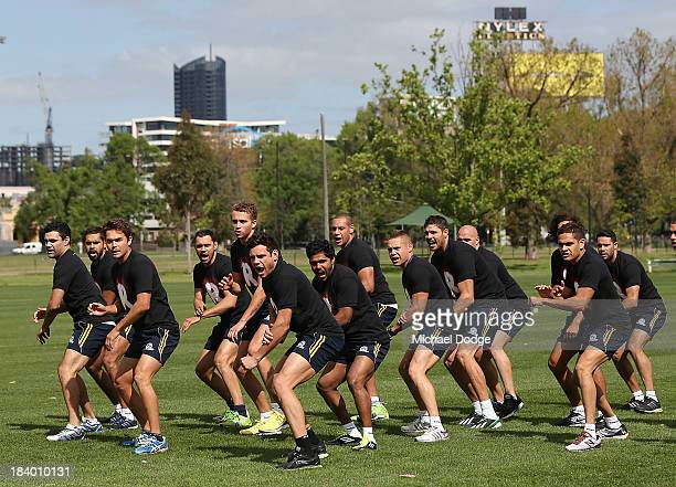 Players perform the War Cry during an Indigenous Australian International Rules Team training session at Gosch's Paddock on October 11, 2013 in...