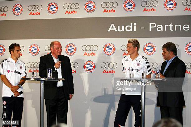 Players Philipp Lahm Bastian Schweinsteiger and manager Uli Hoeness of Bayern Muenchen speak during a press conference at Audi car factory on July 29...