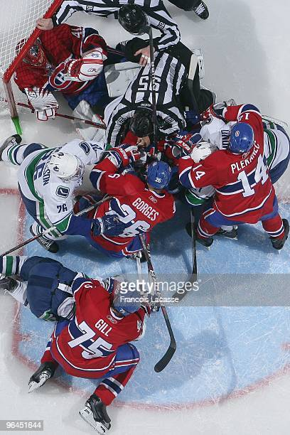 Players piles up in Jaroslav Halak of the Montreal Canadiens net during the NHL game against the Vancouver Canucks on February 2, 2010 at the Bell...