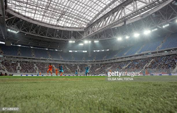 Players play on the pitch during the Russian League football match between FC Zenit and FC Ural at the new 'Saint Petersburg' football stadium also...
