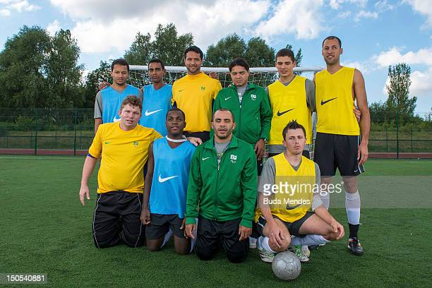 Players pose for a photo during a Football 5 training session at the Brazil Paralympic team's camp in Sportcity Centre on August 20 2012 in...