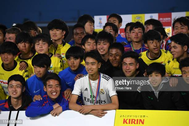 Players pose for photographers after the U16 Kirin Lemon Cup final between Real Madrid and FC Tokyo at Yanagishima Sports Park on April 21, 2019 in...