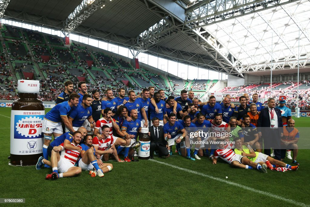 Players pose for photographs after the rugby international match between Japan and Italy at Noevir Stadium Kobe on June 16, 2018 in Kobe, Hyogo, Japan.