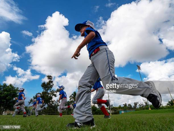 Players practice before a Little League baseball game on November 10, 2018 in Cayay, Puerto Rico. The effort continues in Puerto Rico to remain and...