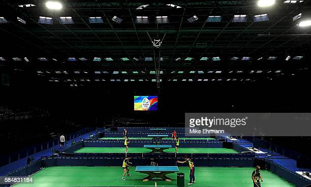 Players practice during a training session for table tennis at the Rio Centro Pavilion for the 2016 Summer Olympic Games on July 31 2016 in Rio de...