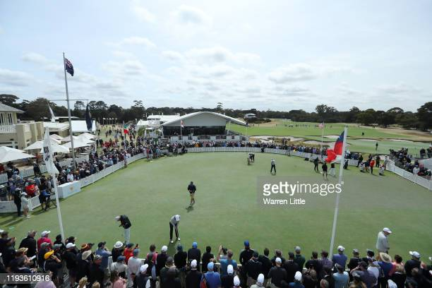 Players practice on the putting green prior to Friday foursome matches on day two of the 2019 Presidents Cup at Royal Melbourne Golf Course on...