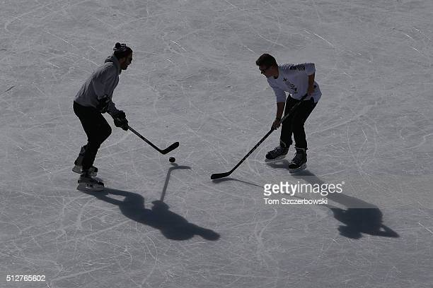 Players practice outdoor shinny hockey during the 7th Annual Lake Louise Pond Hockey Classic on the frozen surface of Lake Louise on February 27 2016...
