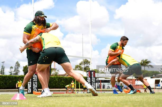 Players practice tacking during the Australian Kangaroos Rugby League World Cup training session at Langlands Park on November 28 2017 in Brisbane...