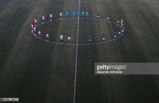 Players pray for victims of coronavirus before a match between Corinthians and Palmeiras as part of the State Championship Final at Arena Corinthians...