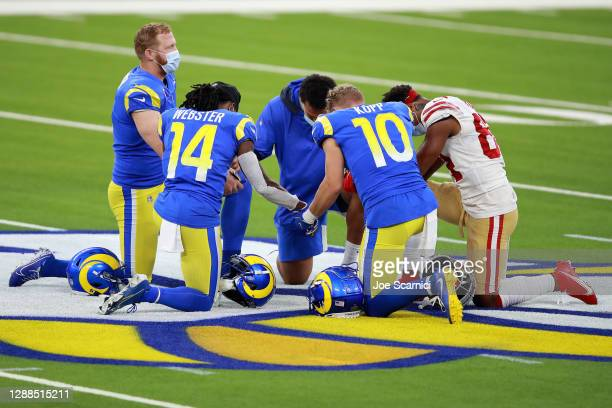 Players pray on the field after the game between the San Francisco 49ers and the Los Angeles Rams at SoFi Stadium on November 29, 2020 in Inglewood,...