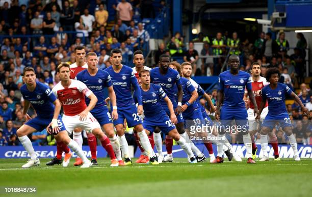 Players prepare for a cross during the Premier League match between Chelsea FC and Arsenal FC at Stamford Bridge on August 18 2018 in London United...