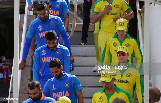 Players prepare to go onto the pitch before the Group Stage match of the ICC Cricket World Cup 2019 between India and Australia at The Oval on June...