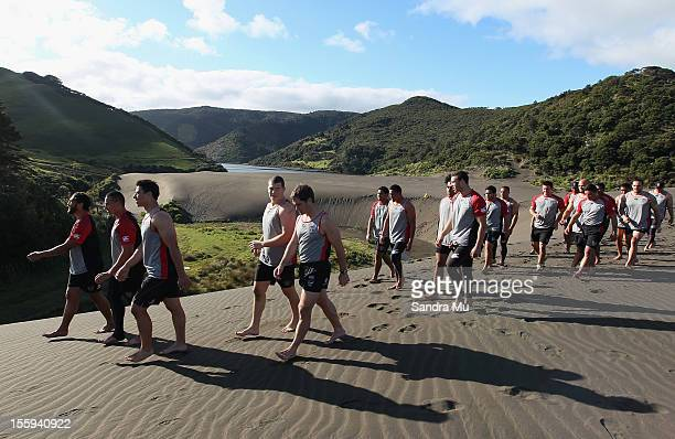 Players prepare to train on the sand dunes during the New Zealand Warriors NRL training session at Bethells Beach on November 10 2012 in Auckland New...