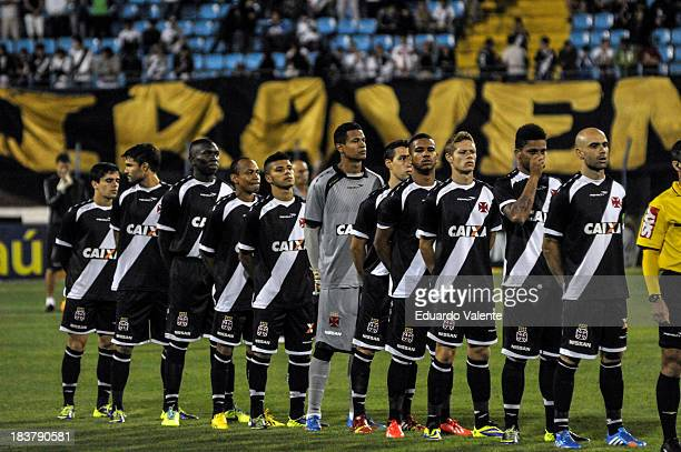 Players profiled singing the Brazilian national anthem before the match between Vasco and Fluminense for the Brazilian Series A 2013 at Ressacada...