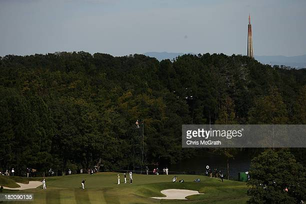 Players putt on the 16th green during day three of the Panasonic Japan Open at Ibaraki Golf Club on September 28 2013 in Ibaraki Japan