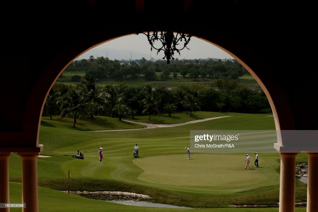 Players putt on the 18th green during round two of The Open Championship International Final Qualifying Asia at Amata Springs Country Club on March 01, 2013 in Bangkok, Thailand.