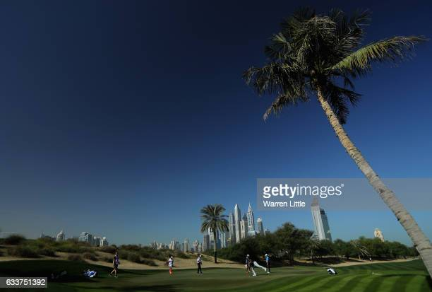 Players putt out on the third green during the completion of the weather delayed second round of the Omega Dubai Desert Classic on the Majlis Course...
