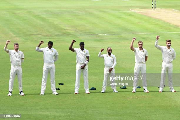 Players raise their fists following the anthems during day 1 of the 1st Betway Test match between South Africa and Sri Lanka at SuperSport Park on...