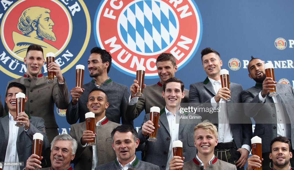 Players raise their glasses during the FC Bayern Muenchen Paulaner photo shoot in traditional Bavarian lederhosen on September 13, 2017 in Munich, Germany.