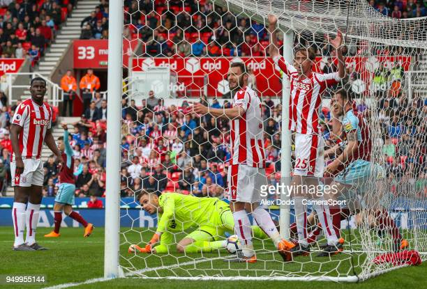 Players react after Burnley's Ashley Barnes scored the equaliser during the Premier League match between Stoke City and Burnley at Bet365 Stadium on...