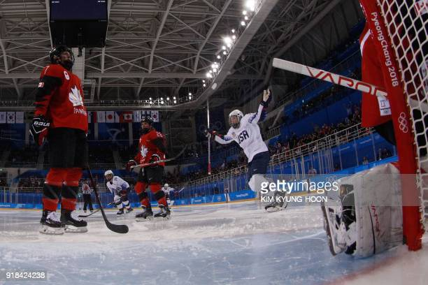 US players react after teammate Kendall Coyne scored in the women's preliminary round ice hockey match between the US and Canada during the...