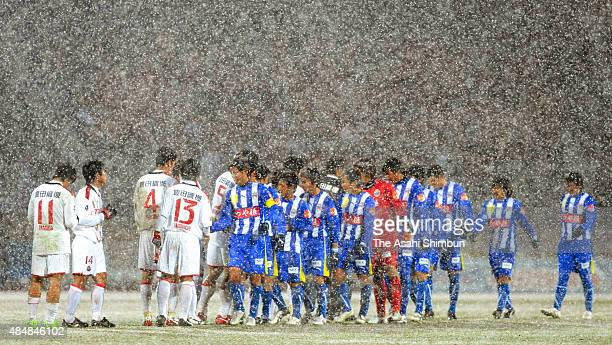 Players react after the 00 draw in the JLeague match between Montedio Yamagata and Nagoya Grampus at ND Soft Stadium on March 14 2009 in Tendo...