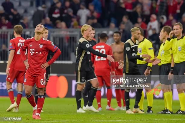 Players react after the UEFA Champions League Group E football match between Bayern Munich and Ajax Amsterdam in Munich southern Germany on October 2...