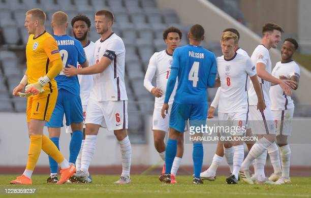 Players react after the UEFA Nations League football match between Iceland v England on September 5, 2020 in Reykjavik.