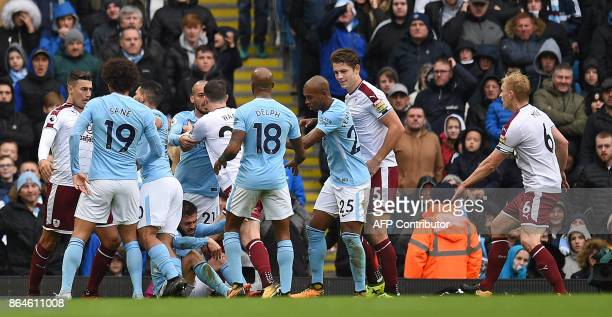 Players react agfter Manchester City's Portuguese midfielder Bernardo Silva was awarded a penalty following a challenge by Burnley's English...