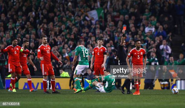 Players react as Neil Taylor of Wales is shown a red card by referee Nicola Rizzoli and is sent off after a challenge on Seamus Coleman of the...