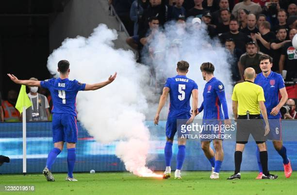 Players react as the game needs to be interrupted due to flares landing on the pitch during the FIFA World Cup Qatar 2022 qualification Group I...