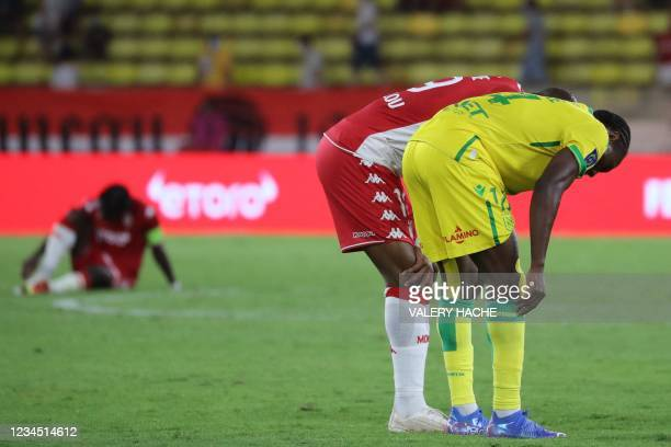 Players react at the end of the French L1 football match between AS Monaco and FC Nantes, at the Louis II stadium in Monaco, on August 6, 2021.