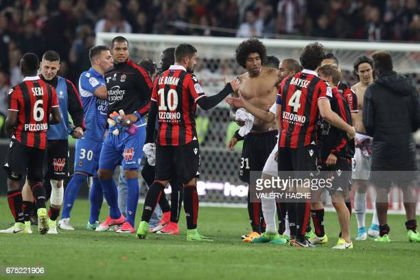 Players react at the end of the French L1 football match Nice vs Paris Saint Germain on April 30 2017 at the 'Allianz Riviera' stadium in Nice...