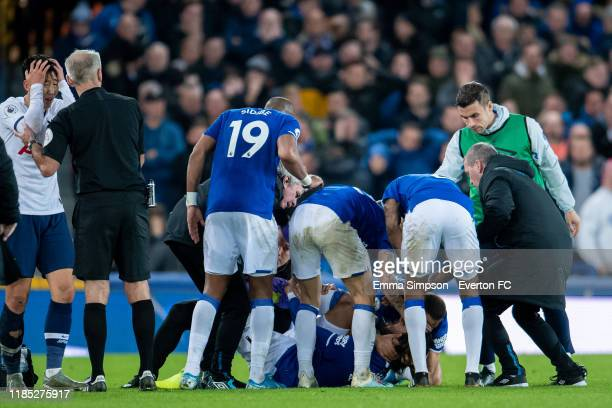 Players react to Andre Gomes' injury after a challenge by Son Heung-min during the Premier League match between Everton FC and Tottenham Hotspur at...
