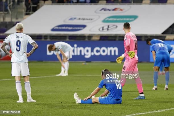 Players react to the draw at the end of the 2022 FIFA World Cup qualifier group F football match between Israel and Scotland at Bloomfield stadium in...