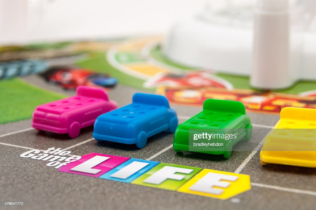 Players ready to start The Game of Life : Stock Photo