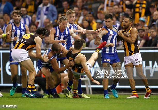 Players remonstrate during the 2018 AFL round five match between the North Melbourne Kangaroos and the Hawthorn Hawks at Etihad Stadium on April 22...