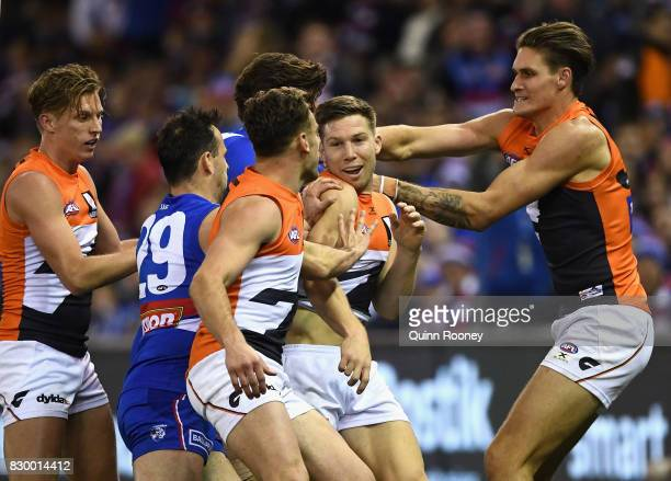Players remonstrate with Toby Greene of the Giants after an incident with Luke Dahlhaus of the Bulldogs during the round 21 AFL match between the...