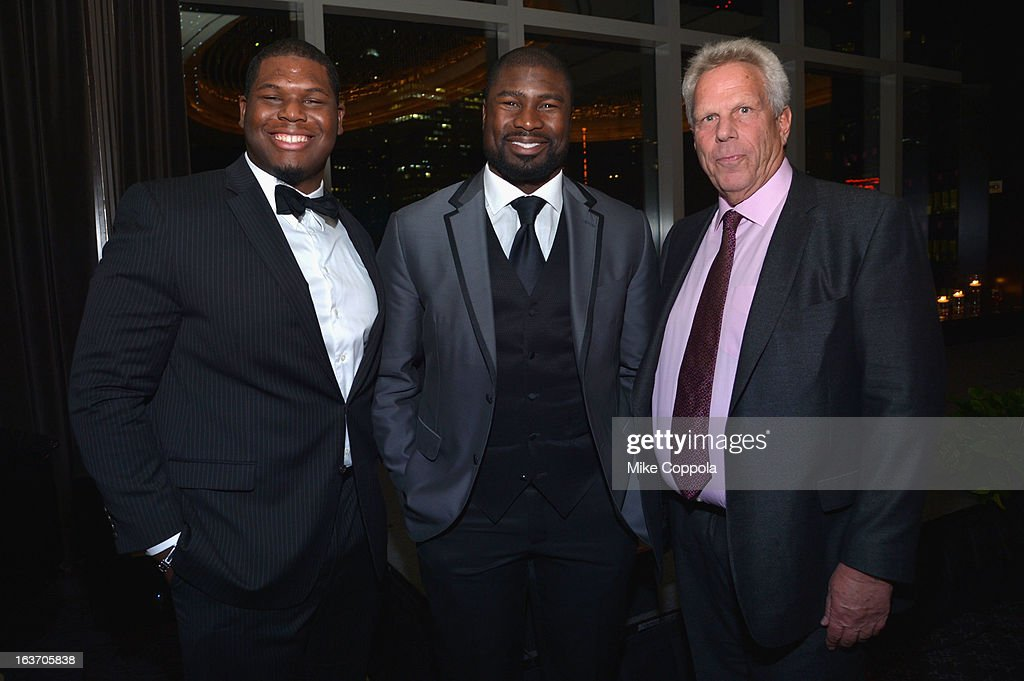 NFL players Ronnie Cameron and Ovie Mughelli, and New York Giants chairman Steve Tisch attend the 2013 Natural Resources Defense Council Game Changer Awards at the Mandarin Oriental Hotel on March 14, 2013 in New York City.