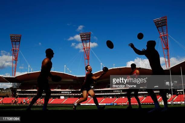 GWS players run drills during a Greater Western Sydney Giants AFL training session at Skoda Stadium on August 21 2013 in Sydney Australia